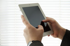 Tablet pc with blank screen in the hands Royalty Free Stock Photos