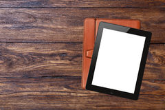 Tablet pc with blank screen on wooden background Stock Images