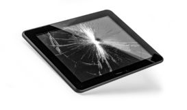 Tablet pc with broken screen. Isolated on white with clipping path royalty free stock photo