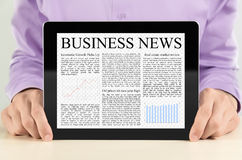 Tablet PC With Business News. Businessman showing digital tablet pc with business news on screen Stock Photos
