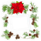 Tablet pc and Christmas decoration. Floral Flat lay background Stock Images