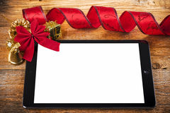 Tablet pc with christmas decorations Stock Photography