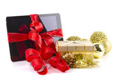 Tablet pc with  Christmas decorations on white Stock Photography