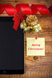 Tablet pc with christmas decorations Stock Images