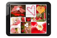 Tablet pc with christmas pictures. Isolated stock photos