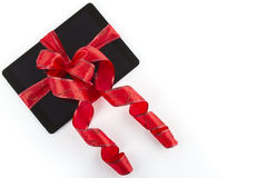 Tablet pc with christmas red ribbon Royalty Free Stock Photo