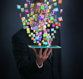Tablet PC with cloud of application icons Royalty Free Stock Photos