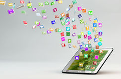 Tablet PC with cloud of application icons Stock Images