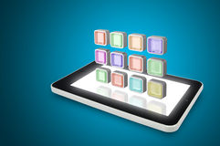 Tablet PC with cloud of colorful application icons Royalty Free Stock Photo