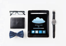 Tablet pc with cloud computing and personal stuff Stock Photo