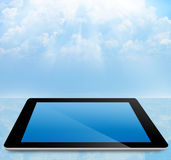 Tablet pc with cloudy sky Stock Image