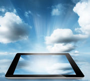 Tablet pc with cloudy sky Stock Images