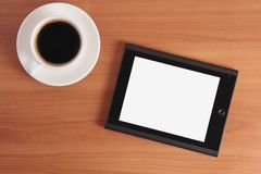 Tablet PC and coffee. royalty free stock image