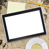 Tablet pc and coffee cup on old concrete surface Stock Photos