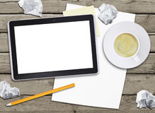 Tablet pc and coffee cup Royalty Free Stock Images