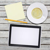 Tablet pc and coffee cup Stock Images