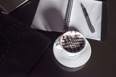 Tablet PC and coffee mugs Stock Photos
