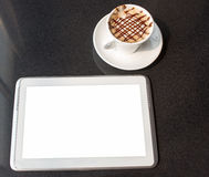 Tablet PC and coffee mugs Royalty Free Stock Images