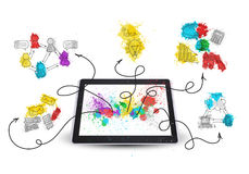 Tablet pc with colored business sketches Royalty Free Stock Photo
