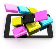 Tablet PC with colorful CMYK application icons Stock Photos