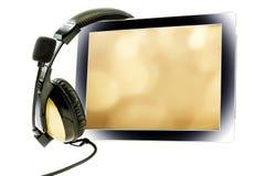 Tablet pc com fones de ouvido Fotografia de Stock Royalty Free