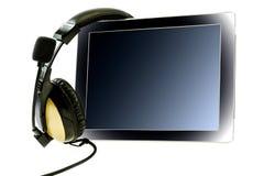 Tablet pc com fones de ouvido Foto de Stock Royalty Free