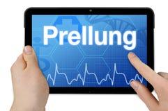Tablet pc com a palavra alemão para a equimose - Prellung fotografia de stock royalty free