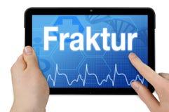 Tablet pc com a palavra alemão para a fratura - Fraktur imagens de stock