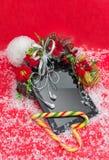 Tablet pc com presente do Natal dos fones de ouvido o melhor Fotografia de Stock Royalty Free