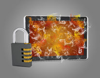Tablet pc with combination lock emits smoke Stock Photography