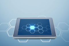 Tablet pc computer with cell pattern on screen Royalty Free Stock Photos