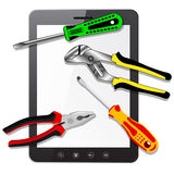 Tablet PC computer  with tools Stock Images