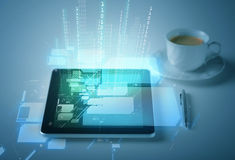 Tablet pc with cup of coffee Royalty Free Stock Images