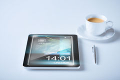 Tablet pc and cup of coffee Stock Photo