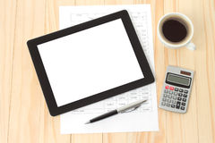 Tablet pc, cup of coffee and paper Stock Photos