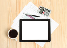 Tablet pc, cup of coffee and paper with graphs Stock Photo