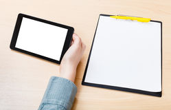 Tablet PC with cut out screen at office table Stock Photo