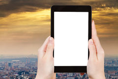 Tablet pc with cut out screen and smog over city Stock Photo