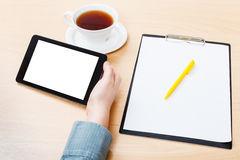 Tablet PC with cutout screen at office desk Stock Photography