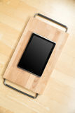 Tablet PC on a cutting board Royalty Free Stock Photography
