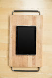 Tablet PC on a cutting board Royalty Free Stock Image