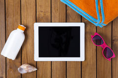 Tablet pc on the deck with summer concept Royalty Free Stock Image