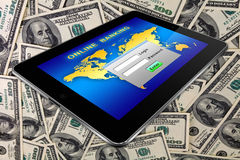 Tablet pc on a dollars. Background Royalty Free Stock Photo