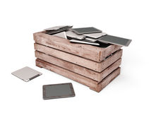 Tablet pc are dumped in an wooden box Royalty Free Stock Photography
