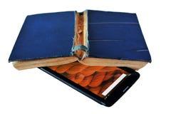 Tablet pc e o livro no fundo branco imagem de stock