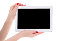 Tablet pc with empty copyspace screen in female hands isolated o Stock Photo