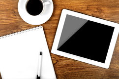 Tablet pc. Tablet with an empty screen close to a pen and cup Stock Photo