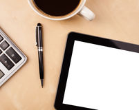 Tablet pc with empty space and a cup of coffee on a desk Stock Photos