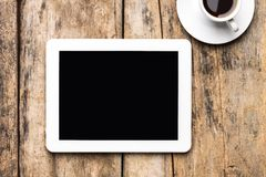 Tablet PC en el fondo de madera Fotografía de archivo libre de regalías
