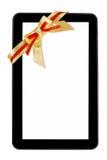 Tablet pc with festive bow Stock Photos